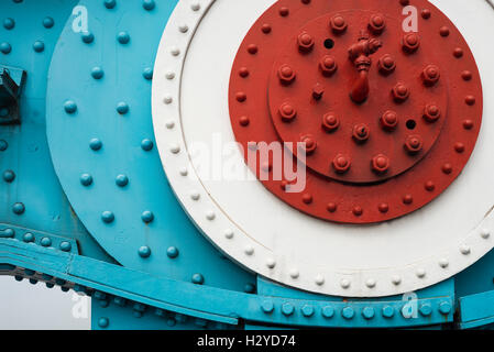 Colorfully painted steel parts with nuts, bolts and rivets of two chain link elements of the Tower Bridge suspension - Stock Photo