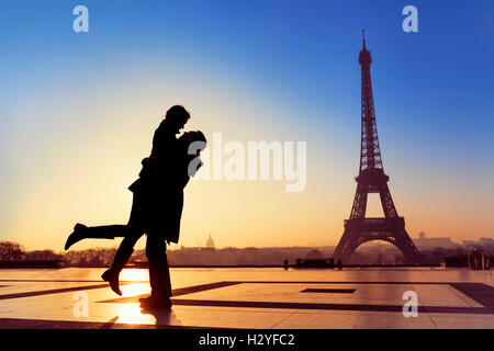 Silhouette of young couple in love with Eiffel Tower background in Paris, France - Stock Photo