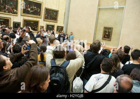 People taking pictures of Mona Lisa, Louvre, Paris, France, Europe - Stock Photo