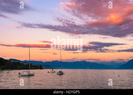 Sunset over boats on Lac Leman, Lausanne, Switzerland - Stock Photo