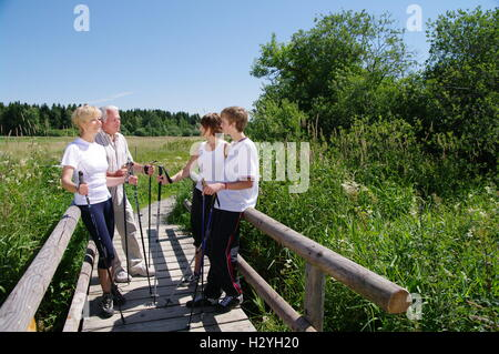 Young and old, Nordic Walking in the Allgaeu - Stock Photo