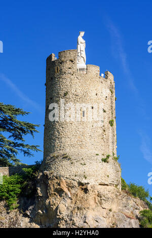 Tournon-sur-Rhône's 16th century watchtower Tour de l'Hôpital with topped by a statue of the Virgin Mary in Tournon - Stock Photo