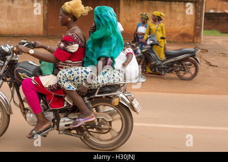 The motor bike is a popular form of transportation in Burkina Faso, West Africa. - Stock Photo