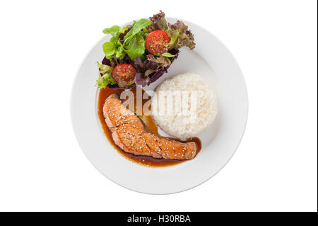 Top view of Fusion food style grilled salmon dressed with Japanese sweet sauce (Teriyaki) including Thai rice garnished - Stock Photo