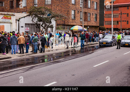 Bogota, Colombia - October 02, 2016: Voters queuing up to enter a polling station on Carrera 9, in the Andean capital - Stock Photo