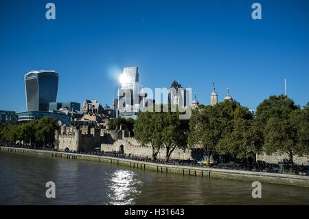 London UK, 3rd October 2016. Sun shines on the City of London. Here are the Tower of London on the river Thames - Stock Photo