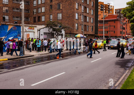 Bogota, Colombia - October 02, 2016: Voters queue up to enter a polling station on Carrera 9, in the Andean capital - Stock Photo