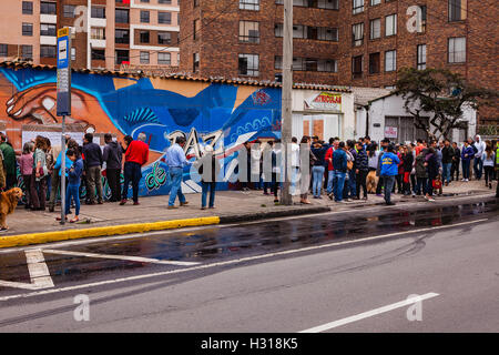 Bogota, Colombia - October 02, 2016: Voters queue up on the right, to enter a polling station on Carrera 9, in the - Stock Photo