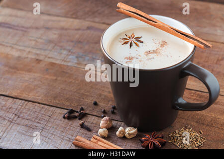 masala chai with spices. Cinnamon Stick, Thai Cardamom, Ginger, Clove, Star Anise, Black Peppercorns, Fennel Seeds, - Stock Photo
