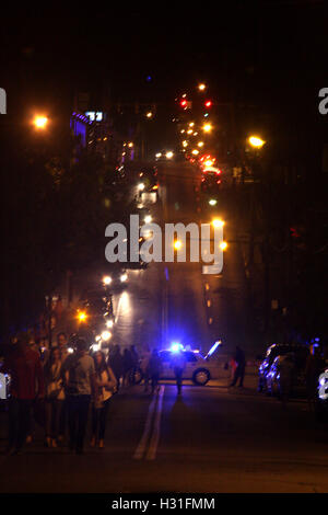 Crowd gathered at city event at night - Stock Photo