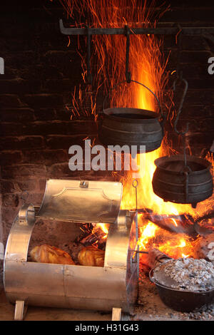 Old style cooking in fireplace - Stock Photo