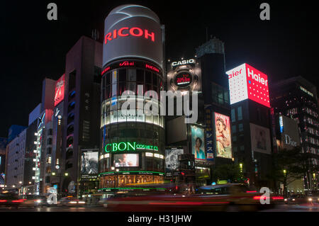 Night view of the busy intersection of Chuo-dori with Yon-chome crossing in Ginza, often called 4-chome intersection - Stock Photo