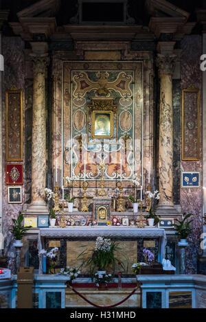 Rome. Italy. La Cappella del Pozzo (Chapel of the Well) Chiesa di Santa Maria in Via, 1594, Largo Chigi. - Stock Photo