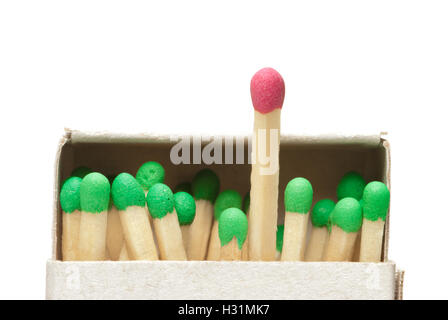 Match boxes and green matches (one match red). A white isolated background.  Available in high-resolution and several - Stock Photo