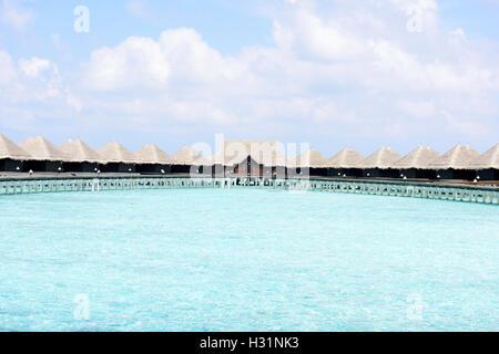 houses on piles on sea. Maldives - Stock Photo
