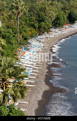Indonesia, Bali, Amed, fishing boats lining east coast beach - Stock Photo