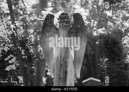 Angel Tombstone Gravestone at Highgate Cemetery East in London, England. - Stock Photo