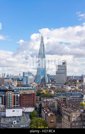 The Shard and Guy's Hospital with Canary wharf in the distance. Taken from the Tate Modern New Switch building top - Stock Photo