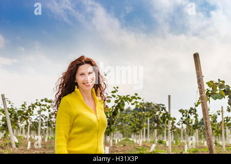 yellow dressed menopausal woman with wrinkles and eye bags enjoying