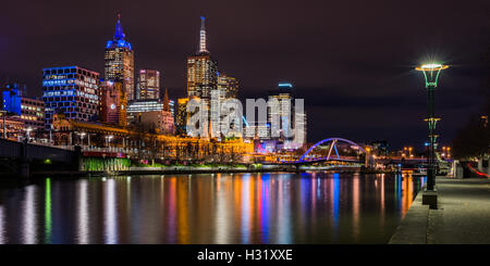 Skyscrapers lit up at night in a city, Central Business District, Melbourne City Centre, Melbourne, Victoria, Australia - Stock Photo