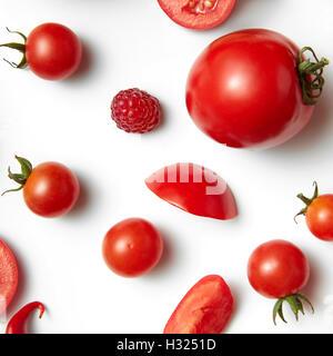 tomato cherry and raspberry isolated on white background - Stock Photo