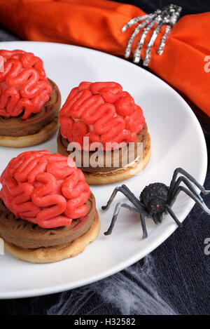 bloody brains out on the marzipan cookie sandwich on Halloween - Stock Photo
