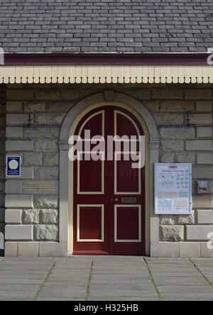 Arched stone door surround with double doors on station building at the east lancashire railway ramsbottom lancashire - Stock Photo