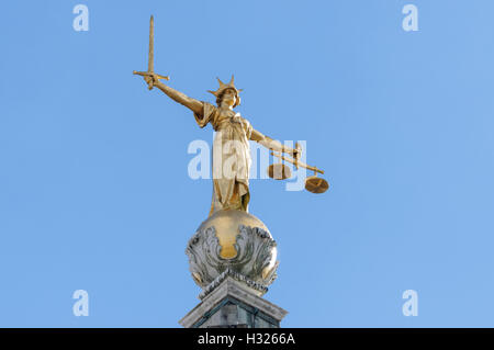 Statue of Lady Justice atop the Old Bailey, Central Criminal Court of England and Wales, London England United Kingdom - Stock Photo