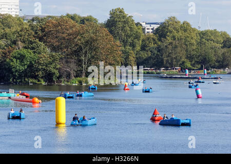Boats on the Serpentine lake in Hyde Park, London England United Kingdom UK - Stock Photo
