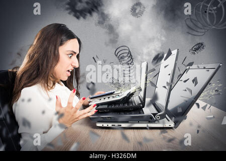 Businesswoman overworked worn computers - Stock Photo