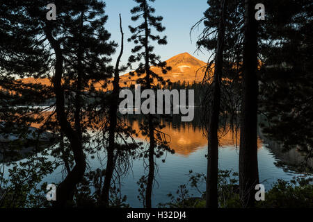 Warm morning light on Pyramid Peak and the Crystal Range, viewed from Lake of the Woods in the Desolation Wilderness, - Stock Photo