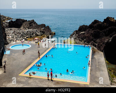 A swimming pool besides the sea at Camara de Lobos on the Portuguese island of Madeira - Stock Photo