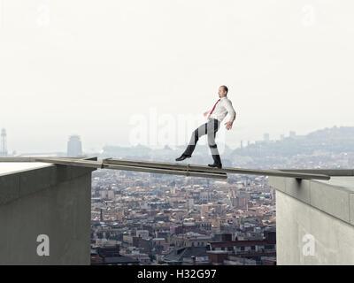 business man walk on danger improvised bridge - Stock Photo