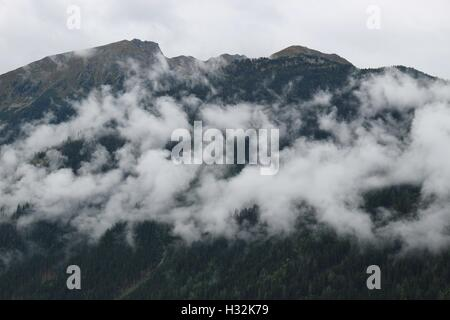 Fog in the mountains, on a September evening. Near Jerzens, in the valley Pitztal in Tyrol, Austria, Europe. - Stock Photo
