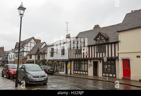 Historic buildings in main street of Stratford-upon-Avon, Warwickshire, England on rainy day - Stock Photo