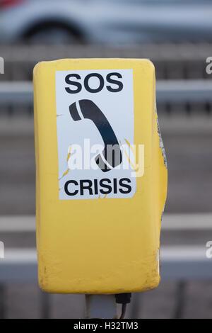 A yellow crisis helpline phonebox on the Forth Road Bridge Scotland. - Stock Photo