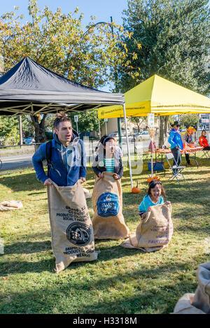 Coffee sack race at Fall Fair, Pandora Park, Vancouver, British Columbia, Canada - Stock Photo