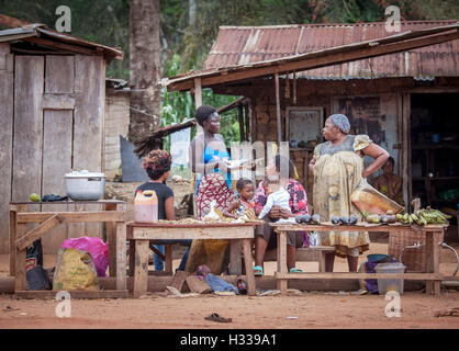 Street scene, woman at a food stall, village near the town of Campo, Southern Region, Cameroon - Stock Photo