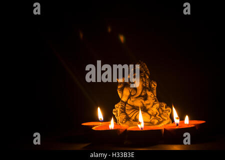 lord ganesha with oil lamp - Stock Photo