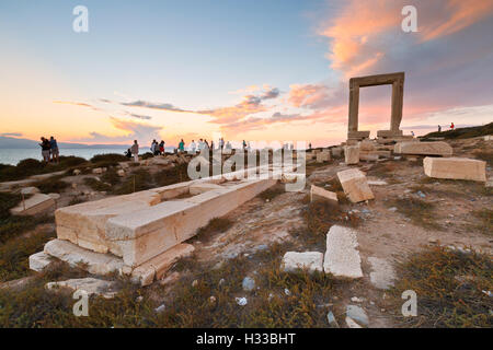 View of Portara and remains of temple of Apollo at sunset. - Stock Photo