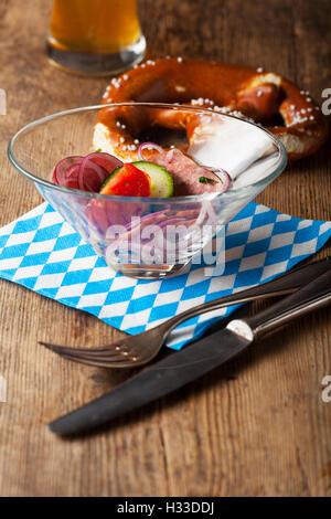 bavarian sausage salad on wood - Stock Photo