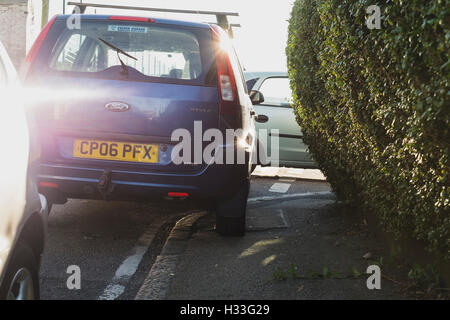 Example of an irresponsible driver  parking illegally on the pavement in Marlborough Road, Falmouth, Cornwall - Stock Photo