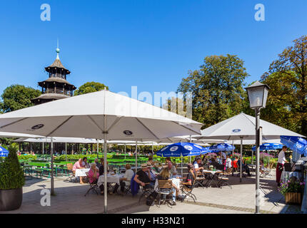 Restaurant at the Chinesischen Turm (Chinese Tower) in the Englischer Garten, Munich, Bavaria, Germany - Stock Photo
