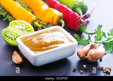 sauce from green tomato and chili pepper - Stock Photo