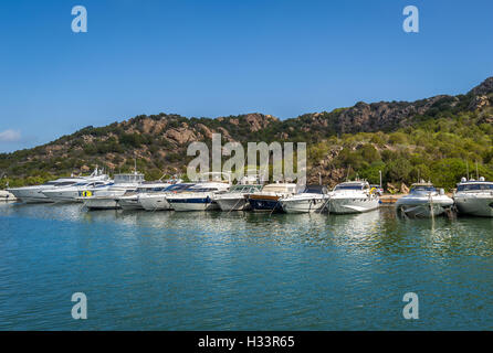 Long pier with recreational fleet boats. Poltu Quatu resort marina, Sardinia. - Stock Photo