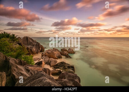 Beautiful Seychelles tropical beach Anse Source D Argent at La Digue island in sunset - Stock Photo