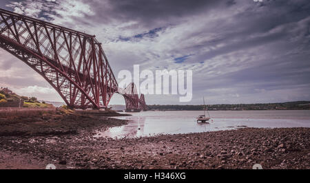 Forth Rail Bridge in Edinburgh, Scotland, connecting the towns of North and South Queensferry - Stock Photo