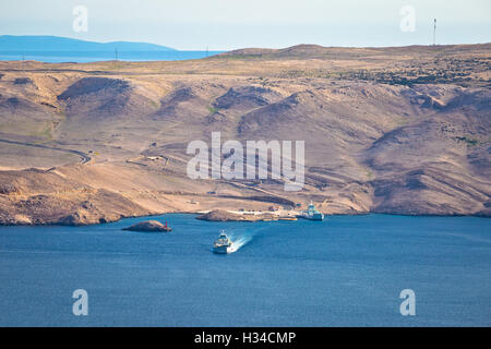 Island of Pag stone desert and ferry port view, Dalmatia, Croatia - Stock Photo