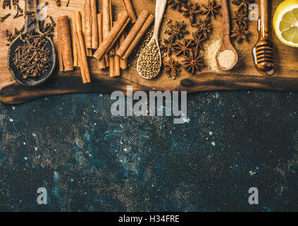 Ingredients for making gluhwein on wooden rustic board, copy space - Stock Photo