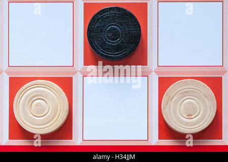 Close up detail of wooden draughts pieces on board game - Stock Photo